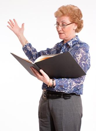 narrator:  Elegant senior lady reading aloud   Stock Photo