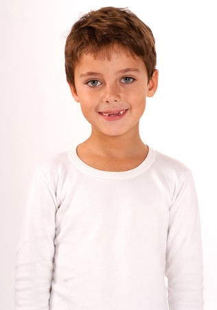 grin:  Smiling cute boy with two front missing teeth  Stock Photo