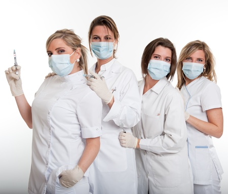 latex woman:     Four female dentists posing with masks and equipment   Stock Photo