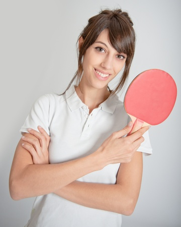 Young woman holding a table tennis racket   photo
