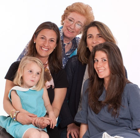 age forty:  A group of women of different ages posing happily   Stock Photo