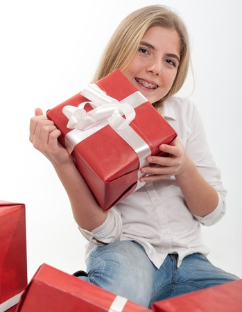 Young teenage girl happily with presents Stock Photo - 11211790