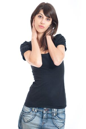 Young think brunette in black t-shirt and denim skirt photo