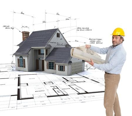 corrections:  Architect holding  plans with a House mock-up on top of blueprints with pen notes and corrections  Stock Photo