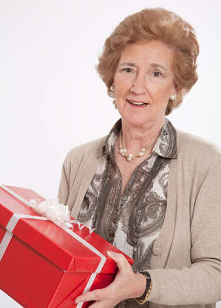 Elegant mature woman holding a red gift box  photo
