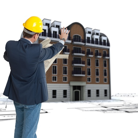An architect, blueprints and an old classical urban building on the background Stock Photo - 11406881