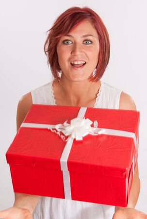 Red haired woman catching a falling red and white present Stock Photo - 11406893