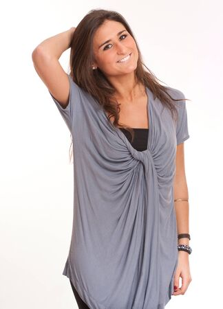 tunic:  Portrait of an attractive young brunette in casual clothes