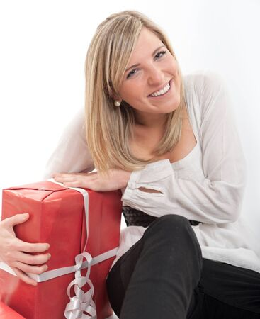 18 19:   Laughing blonde young woman holding a big present