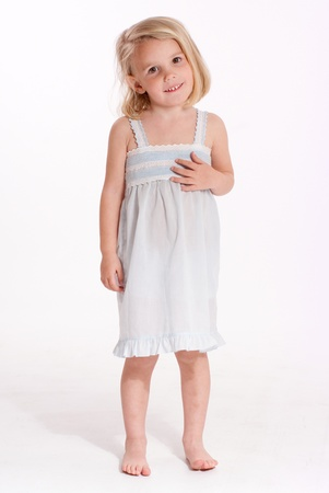 nightdress:  Cute little blonde girl in a nightdress