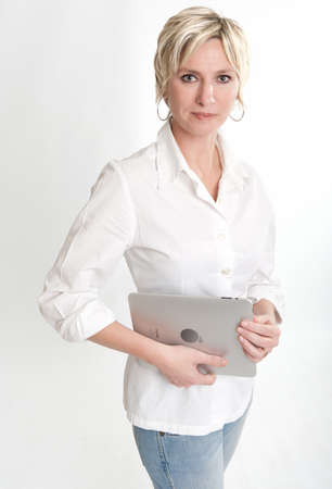 Woman holding a PC tablet with a happy expression   Stock Photo