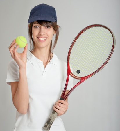 Young woman holding a tennis racket and ball   photo