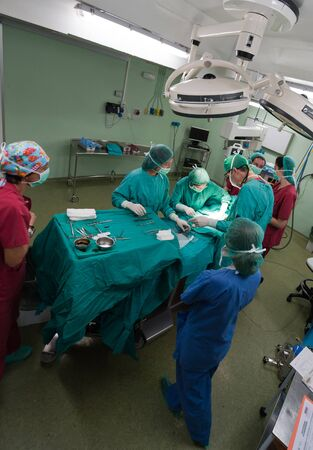 Aerial view of a medical team performing a surgery Stock Photo - 12125545