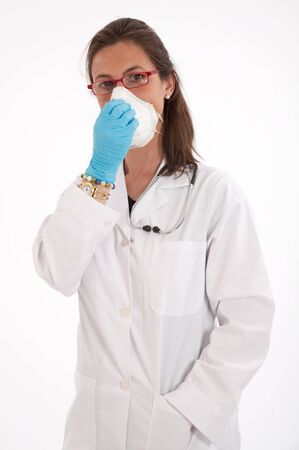 Female doctor wearing a protective mask and gloves  photo