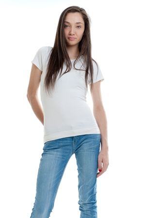 Standing young woman wearing jeans and a white t-shirt  Stock Photo - 12125326