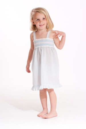 Cute little blonde girl in a nightdress