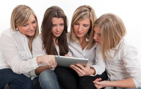 medium group of people:  Group of girls looking at a pc tablet.  Please note that the logo and writing on the tablet are mine. I am attaching a property release, so no copyright issue.