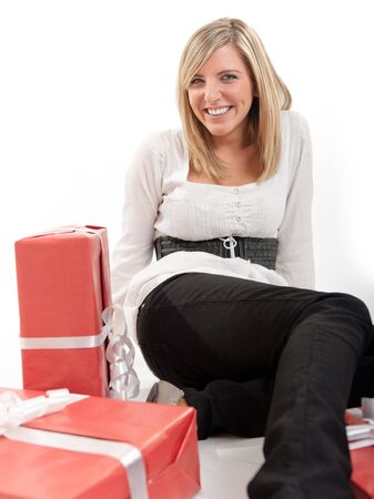 Laughing blonde young woman on the floor with presents  photo