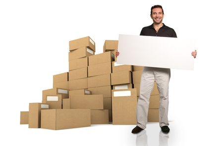 A man holding a blank message board with a background of cardboard boxes Stock Photo - 12202991