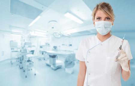 anesthetic: Attractive blonde holding a syringe in an operating room