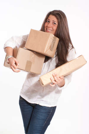 struggling:  Young woman in casual clothes struggling with a pile of parcels  Stock Photo