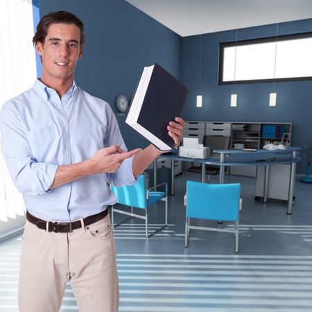 Man showing a book in an office interior