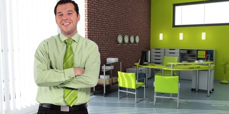 Business man standing in an office in green shades  Stock Photo - 12531989