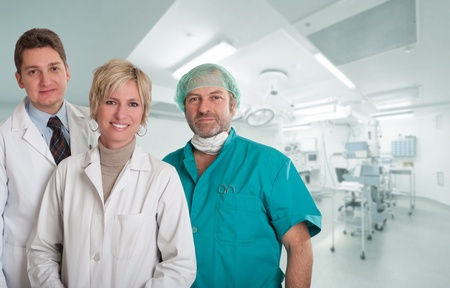 operating table: Medical team, with surgeon, anesthetist and nurse in an operating room