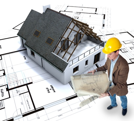 Architect looking at his plans with a house in construction and blueprints   Stock Photo - 12531999