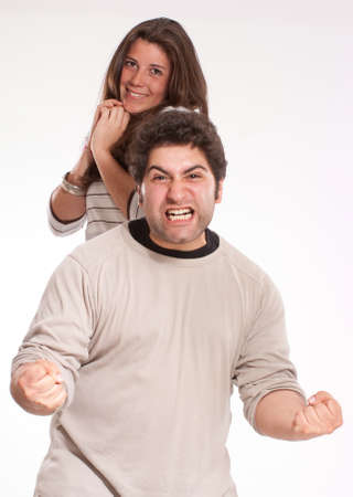 brute:  Strong angry man and admiring young woman  Stock Photo