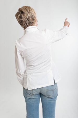 Rear view of a woman pointing at something or dialing   photo
