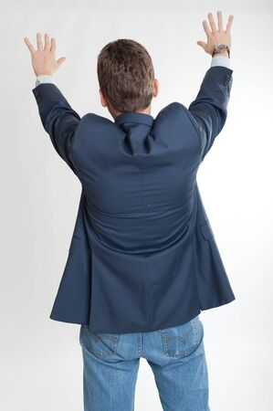 point of view:   Rear view of a man extending his hands