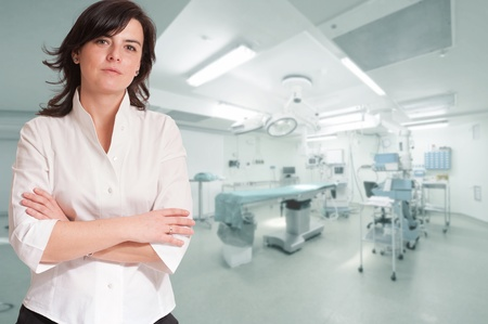 surgery room: Calm reassuring woman in an operating room context