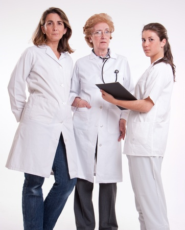 Medical staff team with a surgeon a practitioner and a nurse  photo