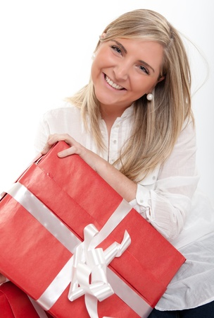 Laughing blonde young woman holding a present Stock Photo - 12528825