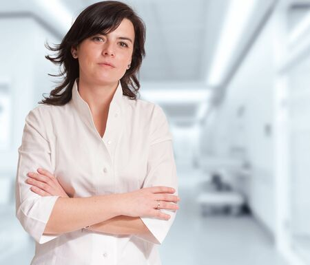 Reassuring woman against a healthcare background Stock Photo - 12528470