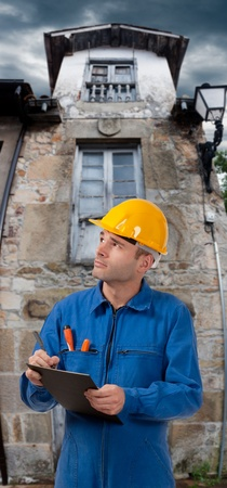 house inspection: Male serviceman taking notes in a small town