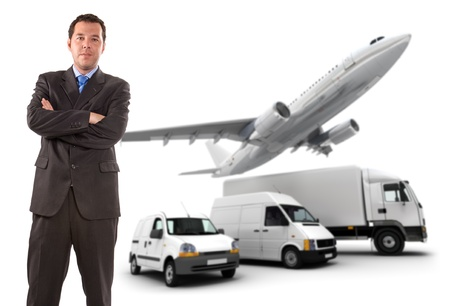 Businessman standing against a transportation fleet photo
