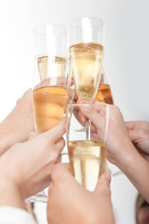 celebration champagne:  Seven hands raising champagne flutes on a toast