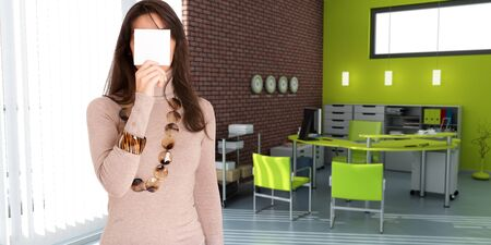 Young woman hiding her face with a blank message in a office Stock Photo - 13133267