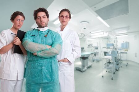 midwife: Medical team, with surgeon, anesthetist and nurse in an operating room