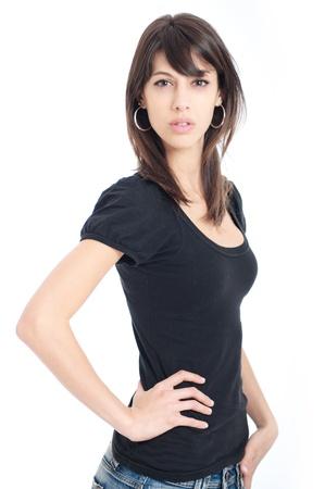 denim skirt:   Young think brunette in black t-shirt and denim skirt
