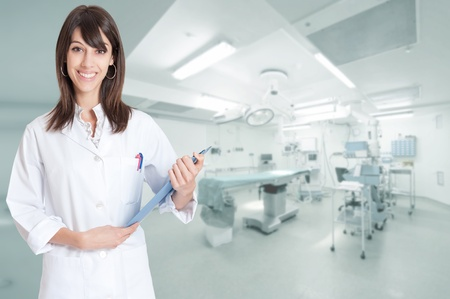 Smiling female healthcare professional with a folder in an operating room Stock Photo - 13116290