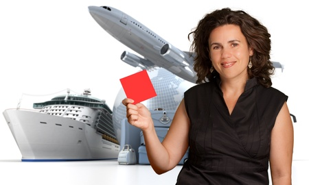 first plane: Smiling woman holding a blank red sign with an international travelling background Stock Photo