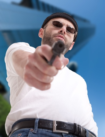 Man with gun in an urban environment  photo
