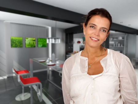 dining table and chairs: Attractive woman standing on a modern open plan kitchen