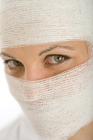eye mask:  Close-up portrait of a woman with a bandaged head and face