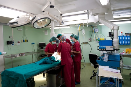 operation lamp: Anesthetic team preparing young patient at the operating theater before surgery