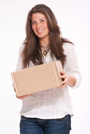 deliver:  Young woman in casual clothes carrying a box  Stock Photo