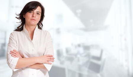 company premises: Portrait of a professional woman against a white background